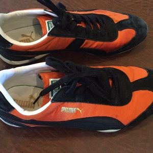 Men's orange and black Puma shoes